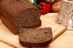 German Dark Wheat Bread over white in restaurant or kitchen.